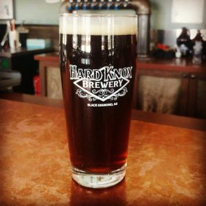 Hard Knox Brewery Freshly Filled Pint Glass Sits Atop Taproom Countertop