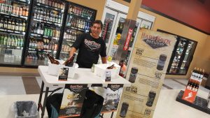 Hard Knox Brewery Craft Beer Stand Setup With Man Smiling Contently