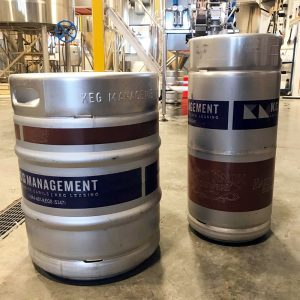 Hard Knox Brewery 50 and 30 Litre Kegs are Shown Sitting Atop of Concrete Surface
