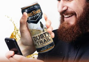 Man Smiles While Taking Selfie with Hard Knox Breweries Own Dusty Trail