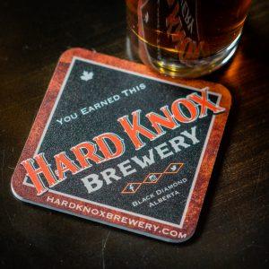 Hard Knox Brewery Beer Sitting on Counter Top, Beside Cardboard Coaster