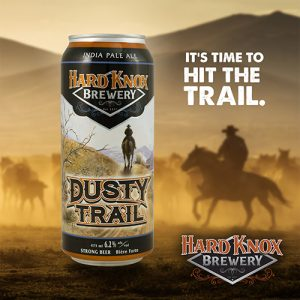Hard Knox Brewery Dusty Trail India Pale Ale with Horses Kicking up Dust in Foothills