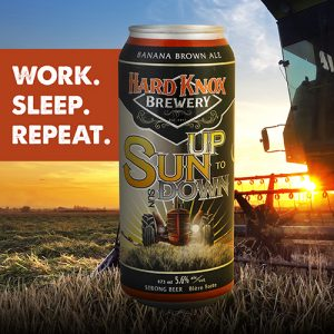 Hard Knox Brewery Sun Up to Sun Down Banana Brown Ale with Tractor in Background as Sun Sets